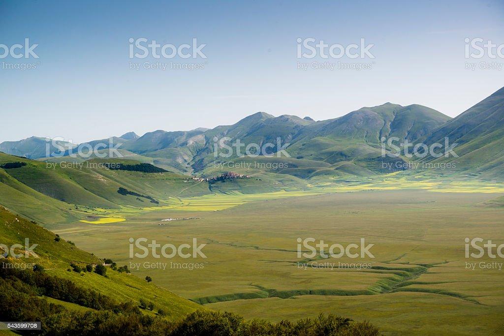 Field between the hills stock photo