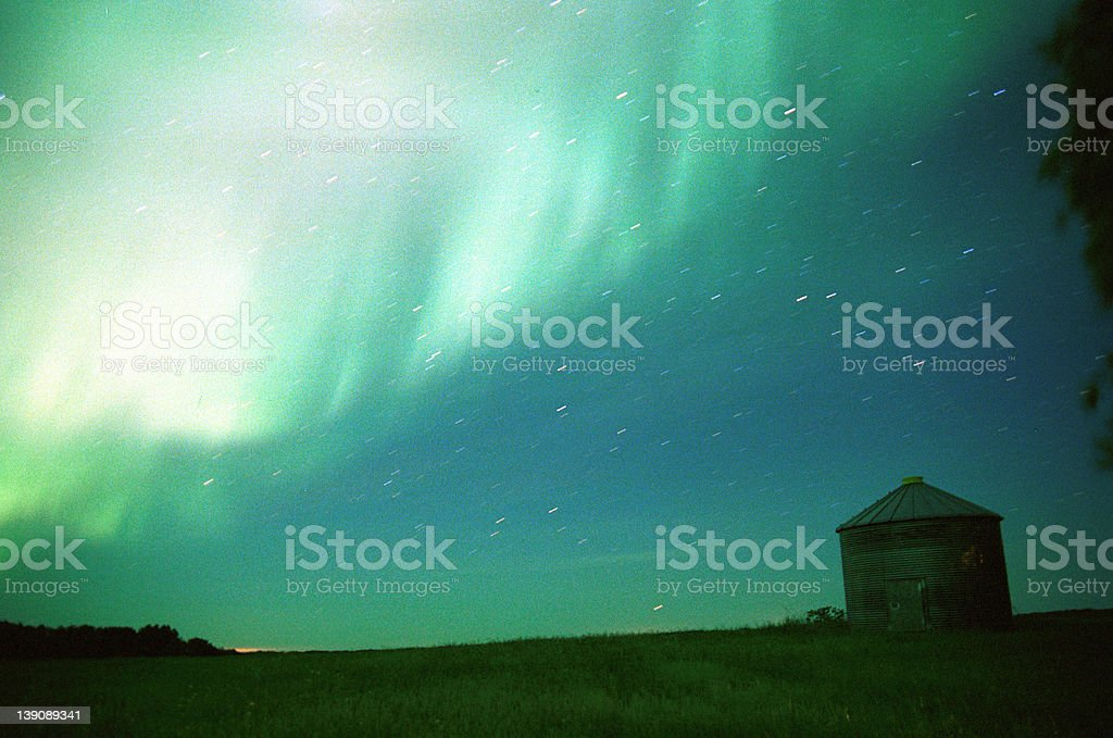 field by northern lights royalty-free stock photo