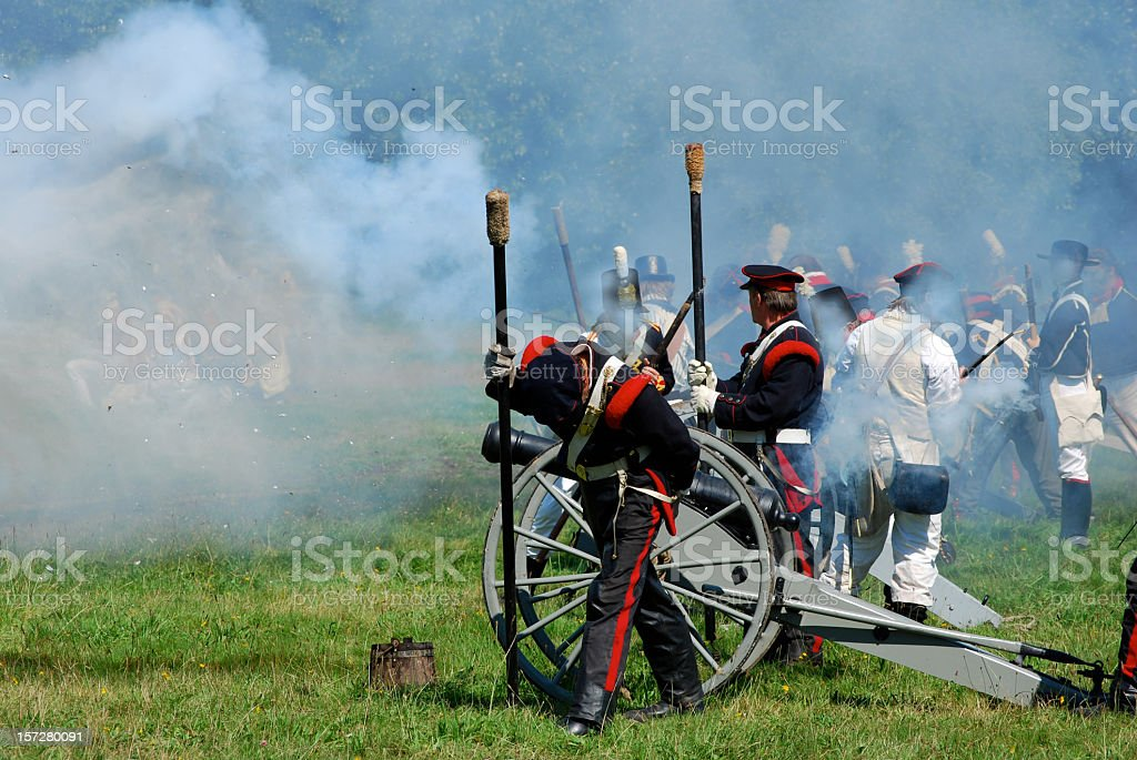 Field cannon and artillery soldiers in a battle re-enactment stock photo