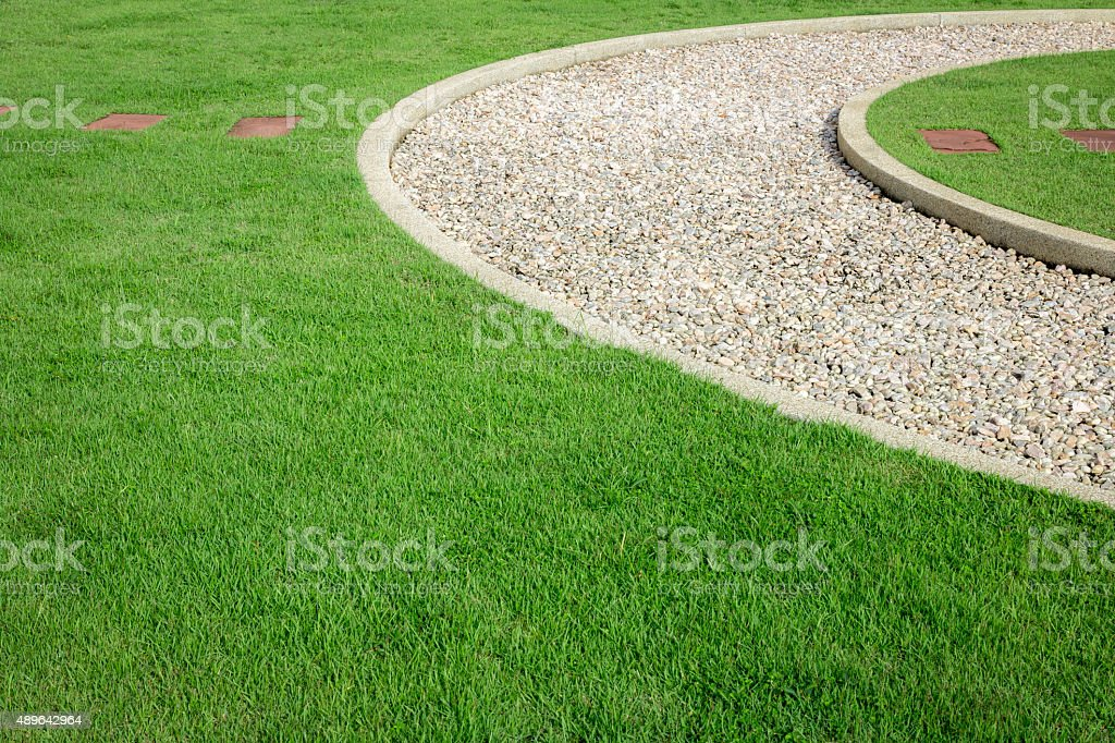 field green grass and white stone stock photo