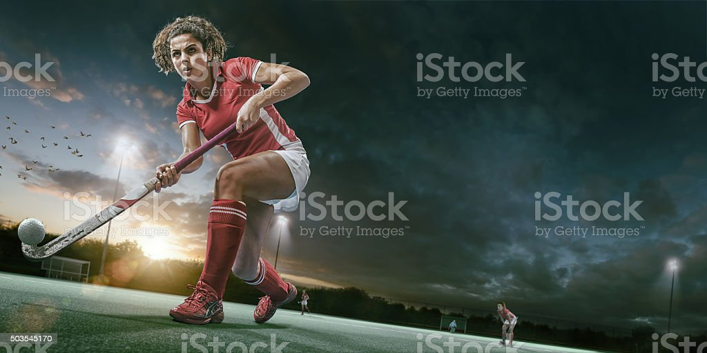 Field Hockey Player in Mid Action During Hockey Game stock photo