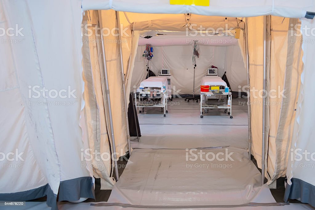 Field hospital tent with beds stock photo