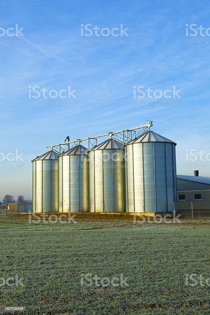field in harvest with silo royalty-free stock photo