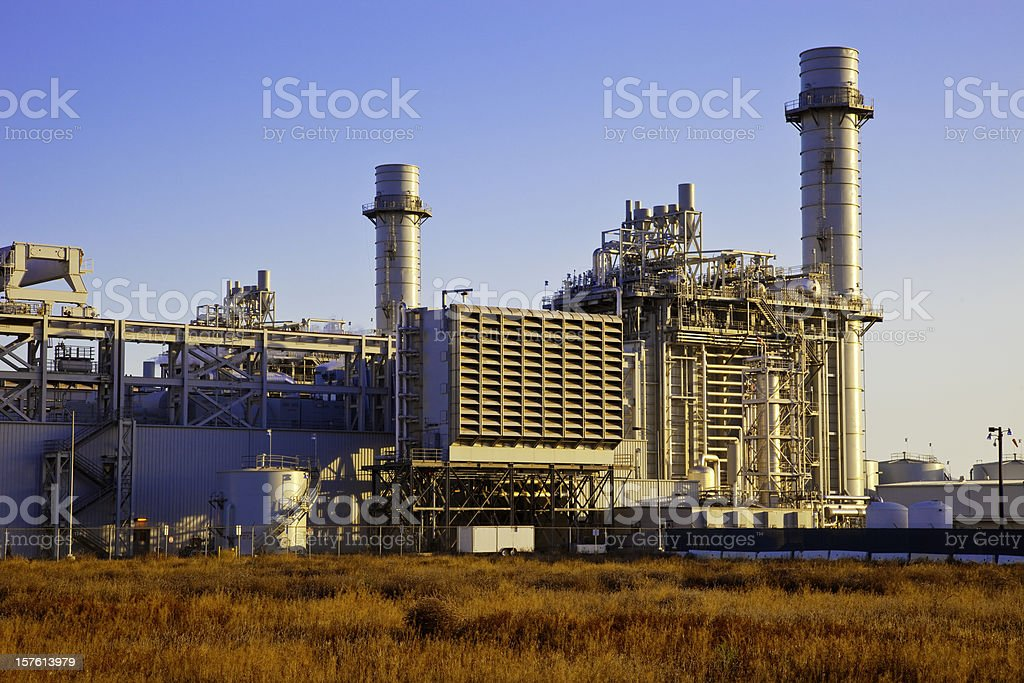Field next to the Natural gas fired electrical power plant royalty-free stock photo