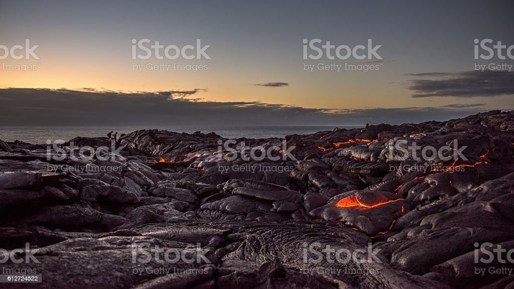 Field of lava on the Pacific coast at dawn stock photo