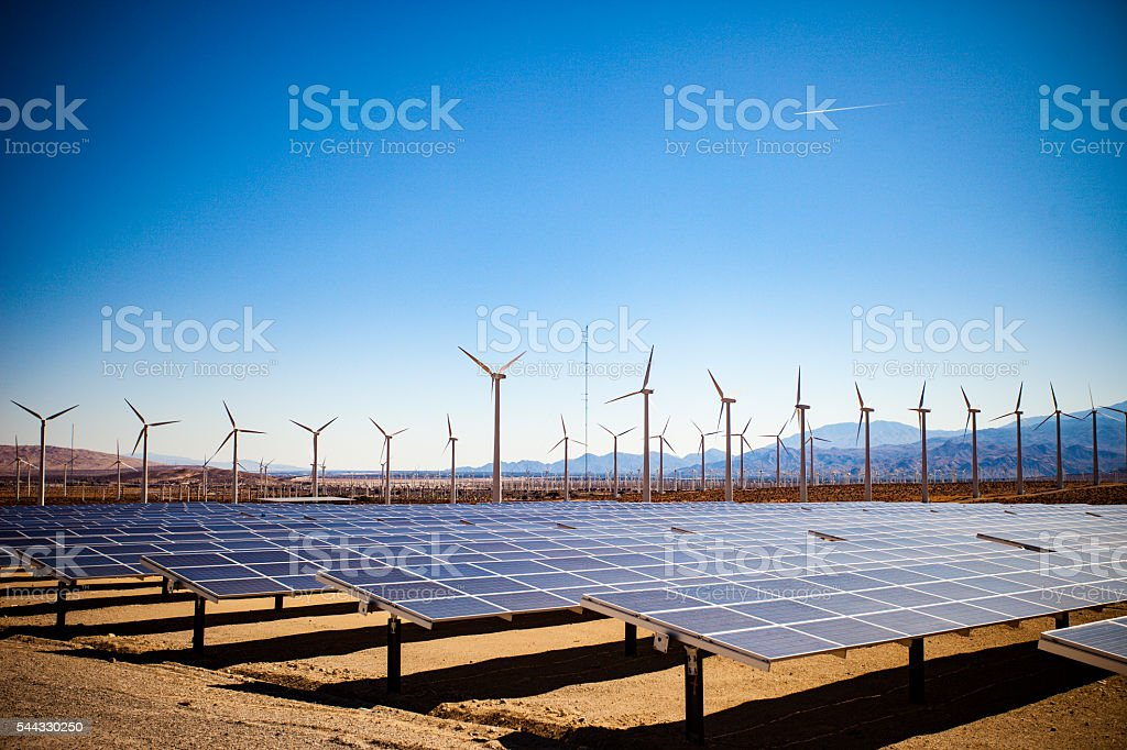 Field of Solar Panels and Windmills stock photo