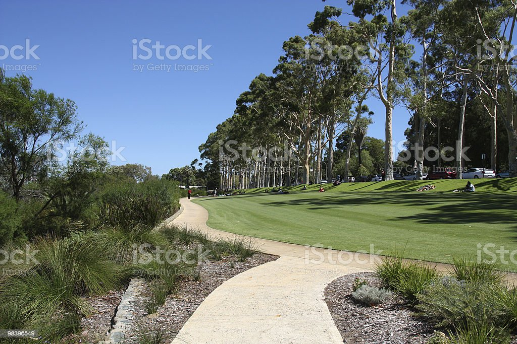 A field or park in Perth Australia with people sitting stock photo