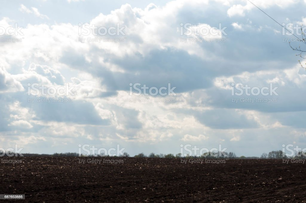 field. rural landscape. cloudy skies. inwardness stock photo