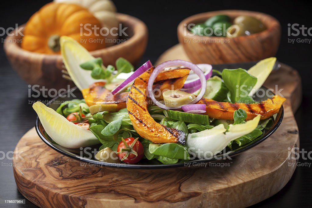 Field salad with grilled pumpkin stock photo
