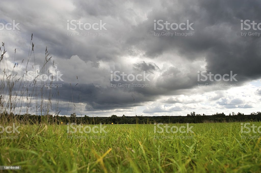 field with dramatic stormy sky royalty-free stock photo