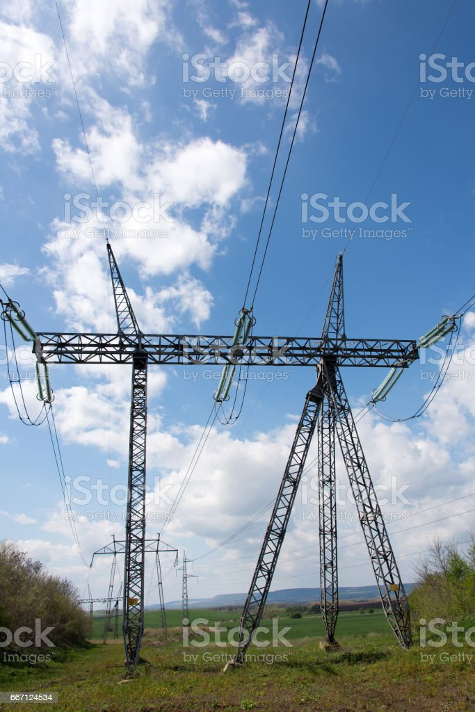 Field with poles for high voltage. stock photo