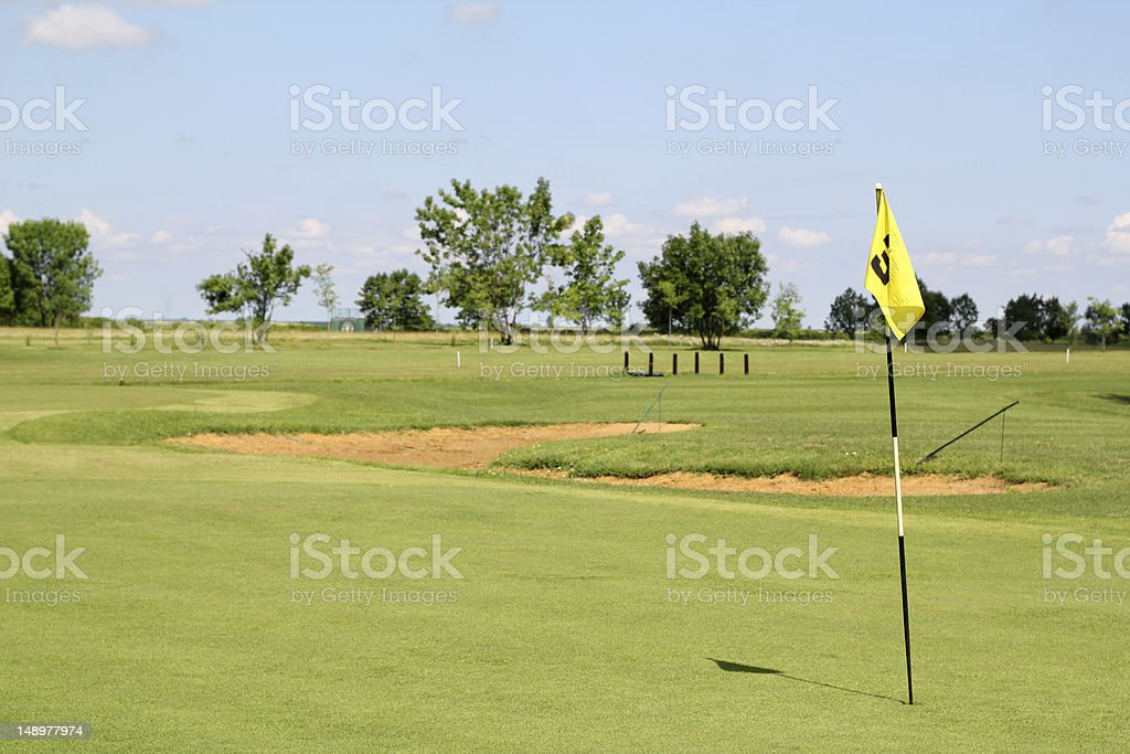 field with yellow golf flag royalty-free stock photo