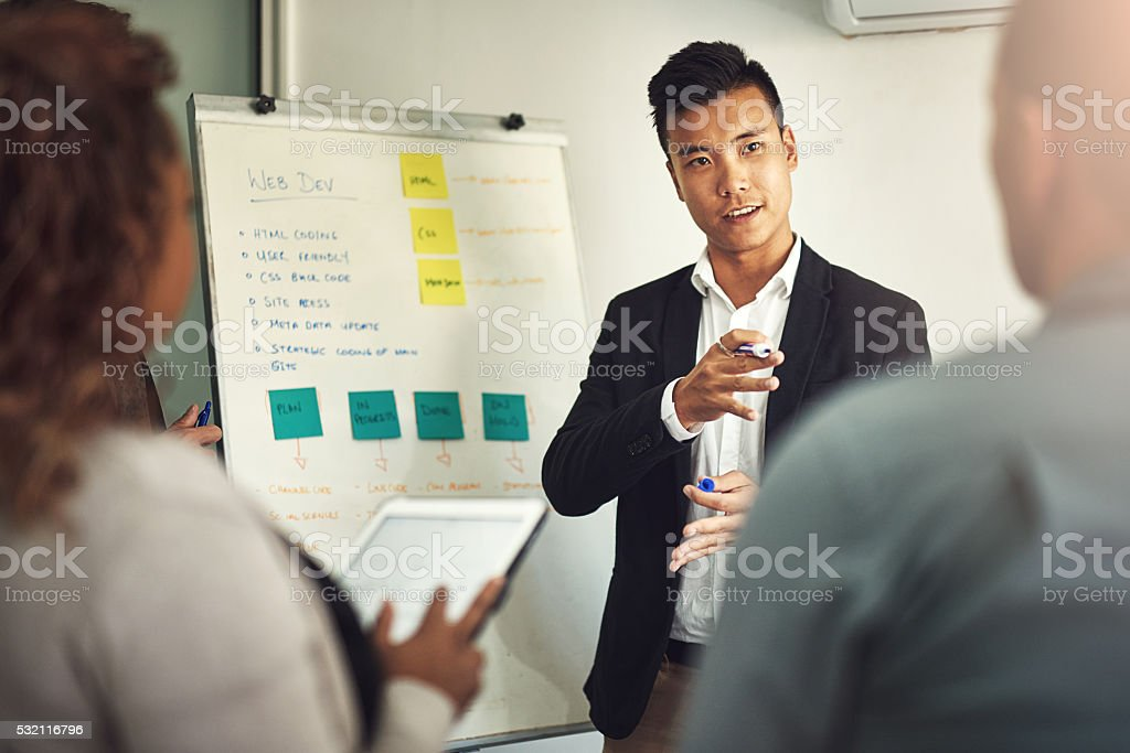 Fielding questions from his team stock photo