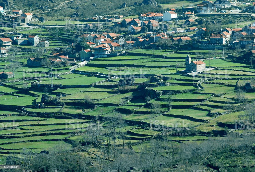 Fields and village in hills of central Portugal stock photo