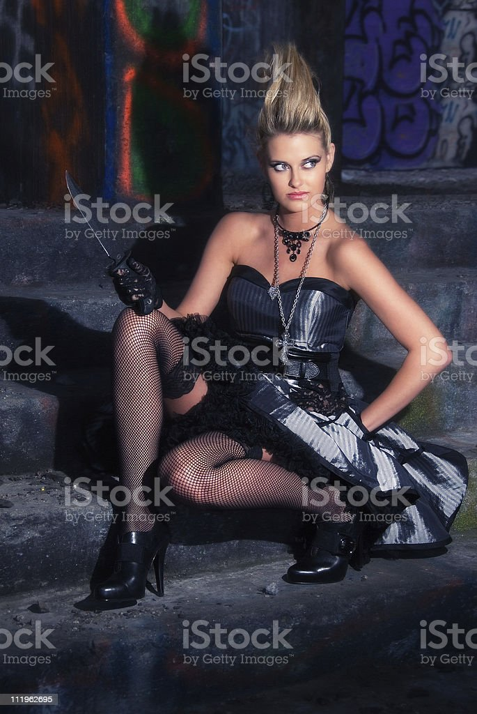 Fierce looking model inside an abandoned house with knife royalty-free stock photo