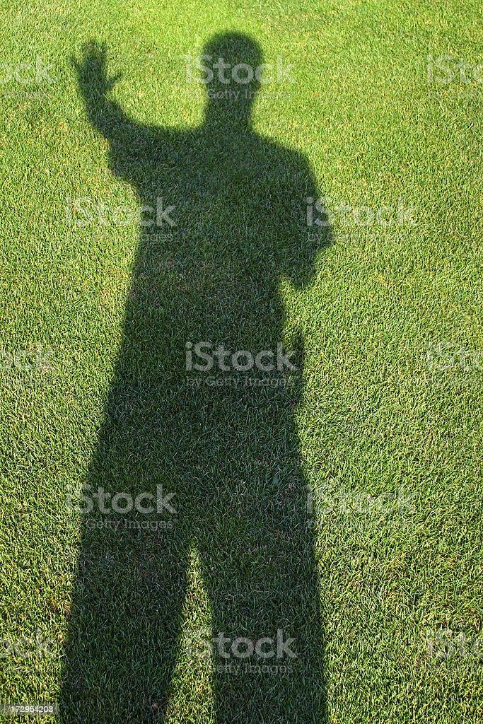 Fierce Shadow Man - shadow on grass royalty-free stock photo