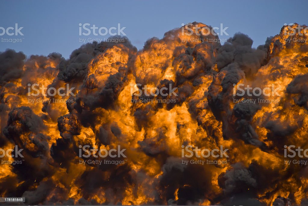 Fiery explosion with thick black smoke on an airport runway. royalty-free stock photo