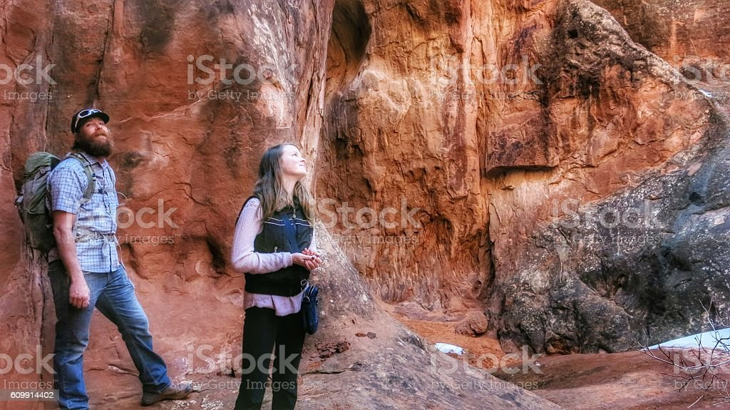 Fiery Furnace, Two Hikers Looking Up, Cathedral, Arches National Park stock photo