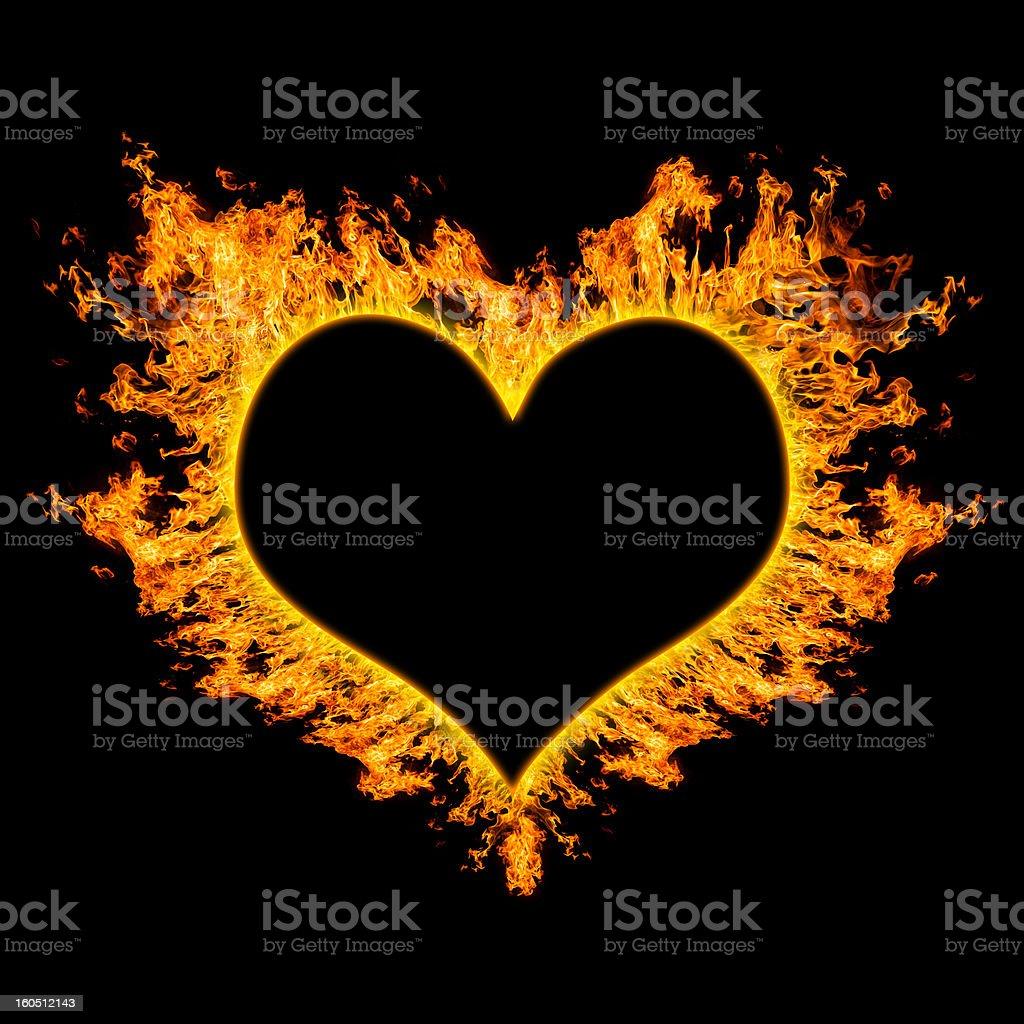 fiery heart on black background. royalty-free stock photo