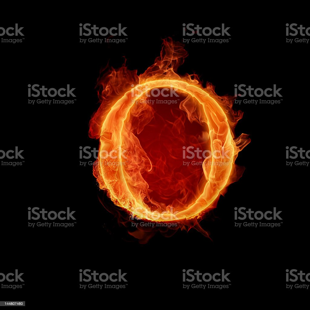 Fiery Letter O shining in dark in black background royalty-free stock photo