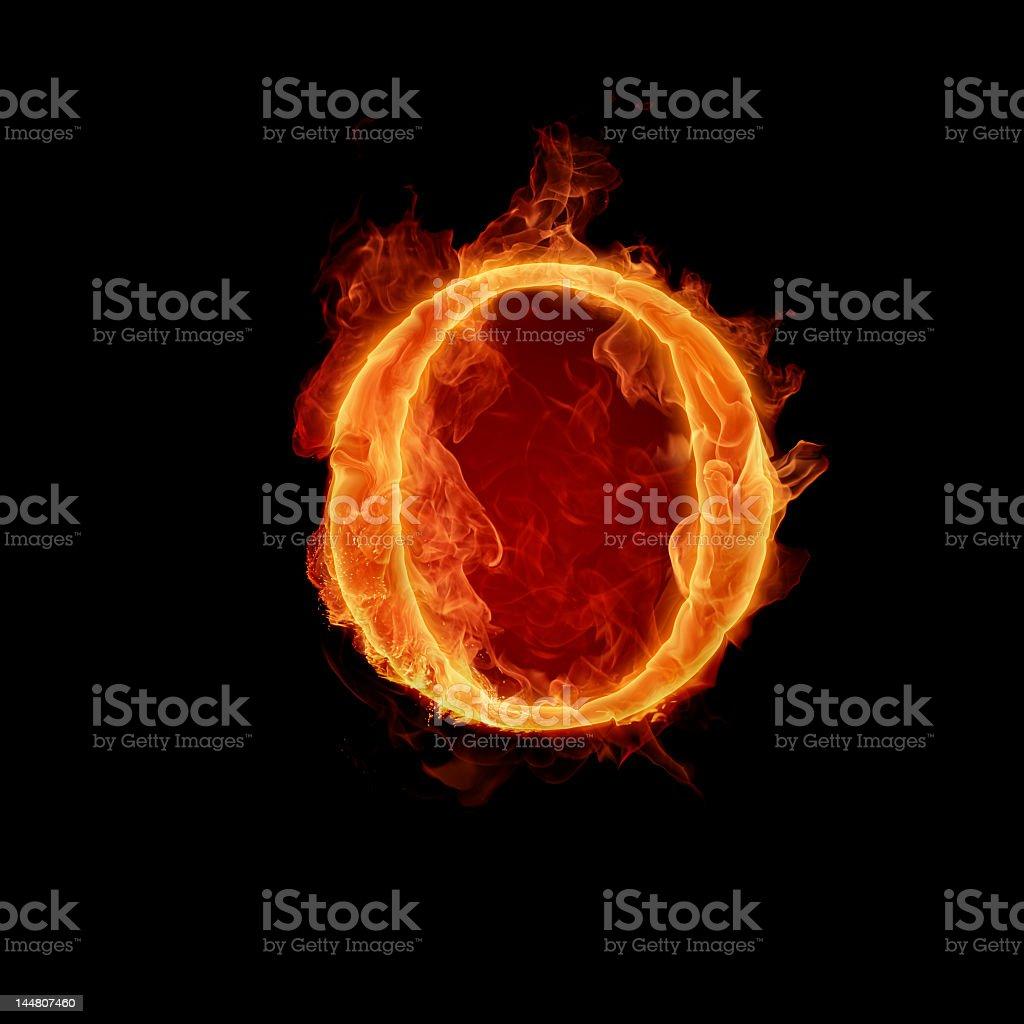 Fiery Letter O shining in dark in black background stock photo
