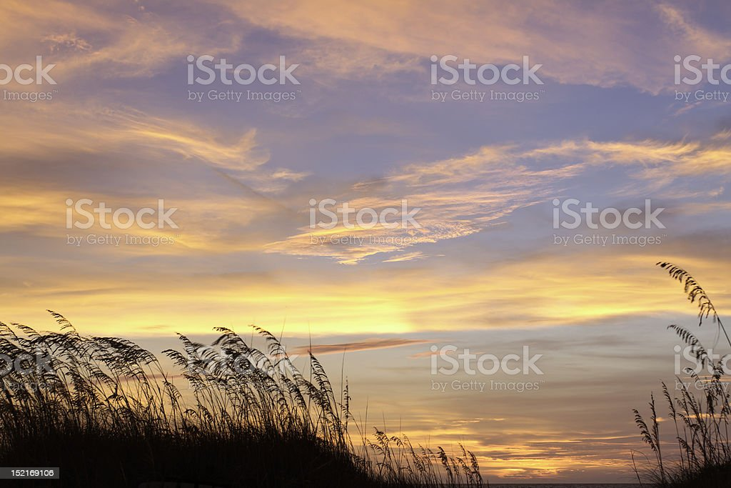 Fiery Red And Orange Sky Over The Ocean stock photo