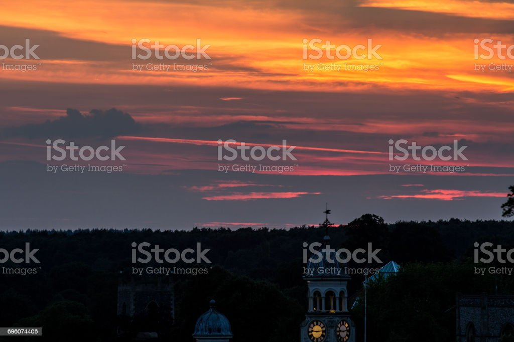 Fiery sunset above historical town stock photo
