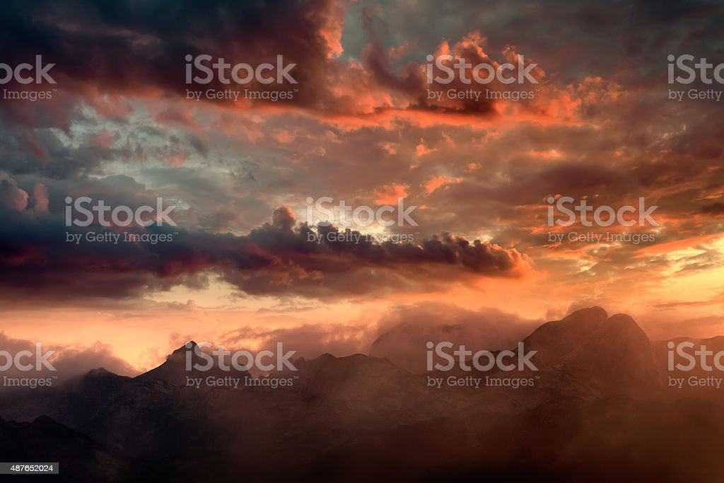 Fiery sunset and hazy mountain peaks stock photo