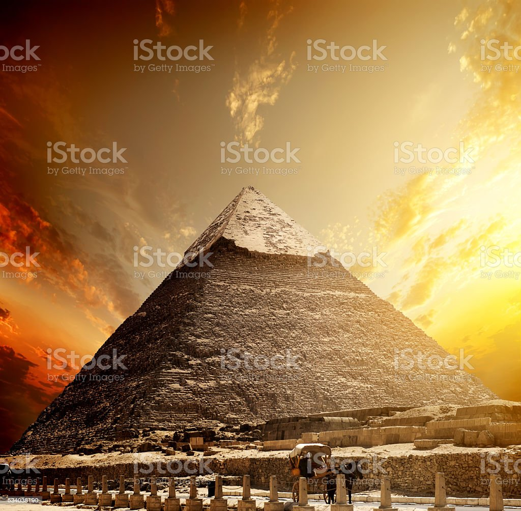Fiery sunset and pyramid stock photo