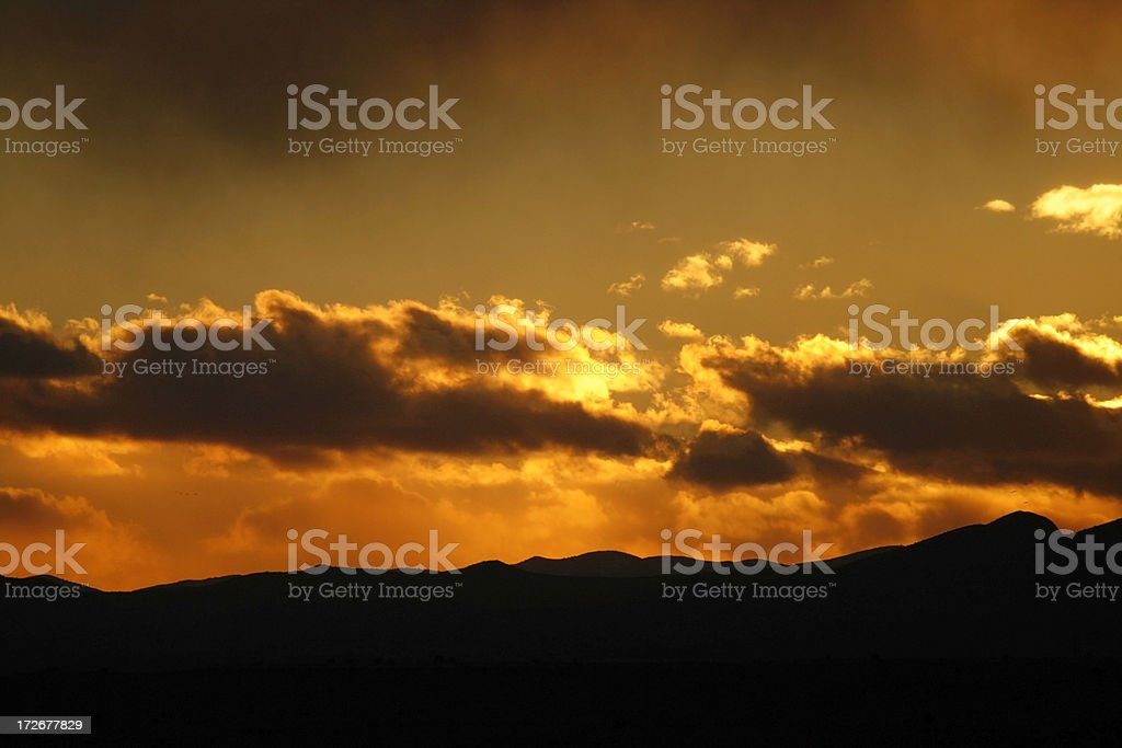 Fiery Sunset over the Mountains royalty-free stock photo