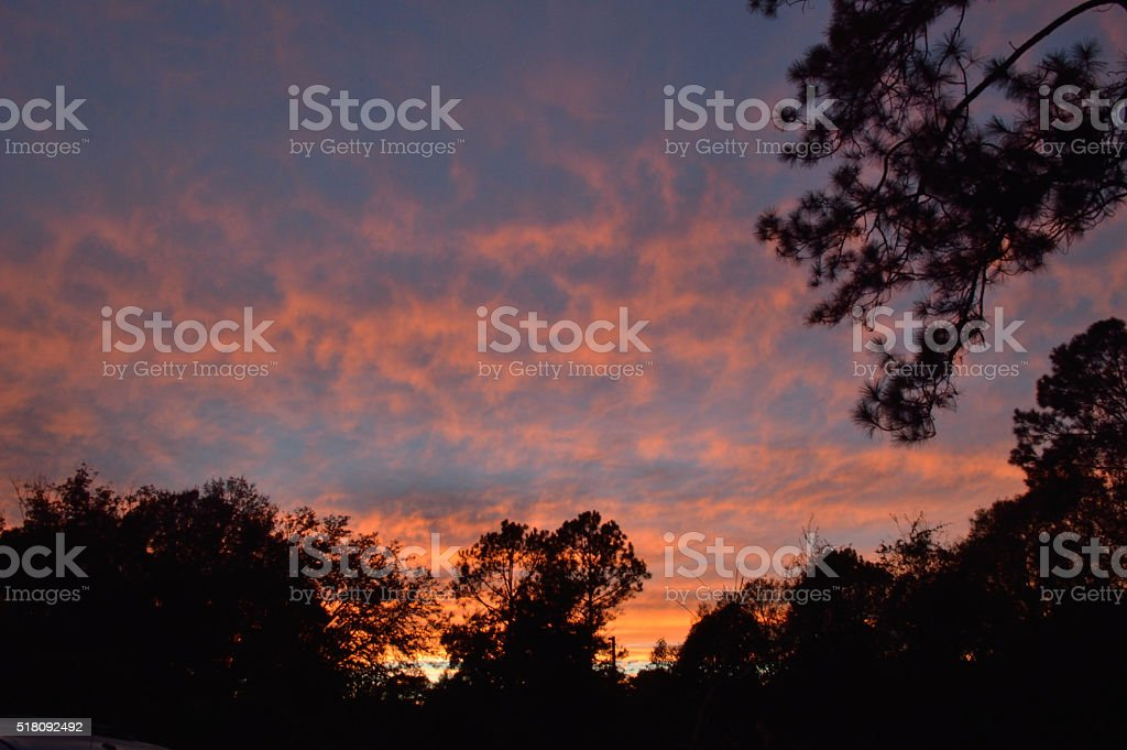 Fiery sunset sky, orange and blue stock photo