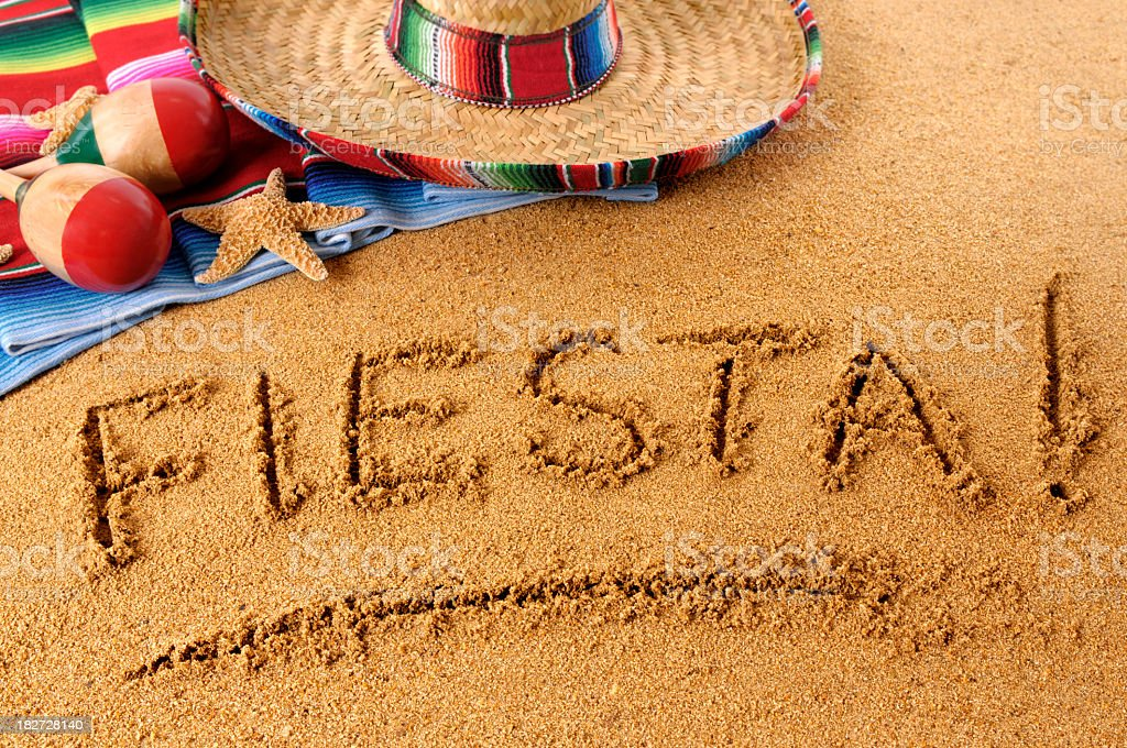 Fiesta written in in sand at beach royalty-free stock photo