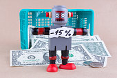 Fifteen percent off word with standing robot