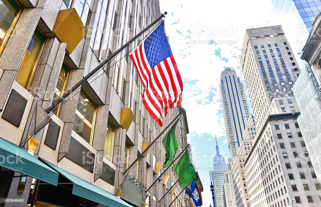 Fifth Avenue and American flag in New York City stock photo