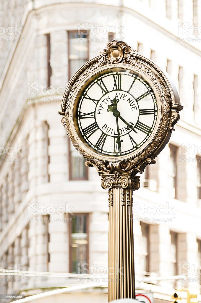 Fifth Avenue Building Clock and Flatiron royalty-free stock photo