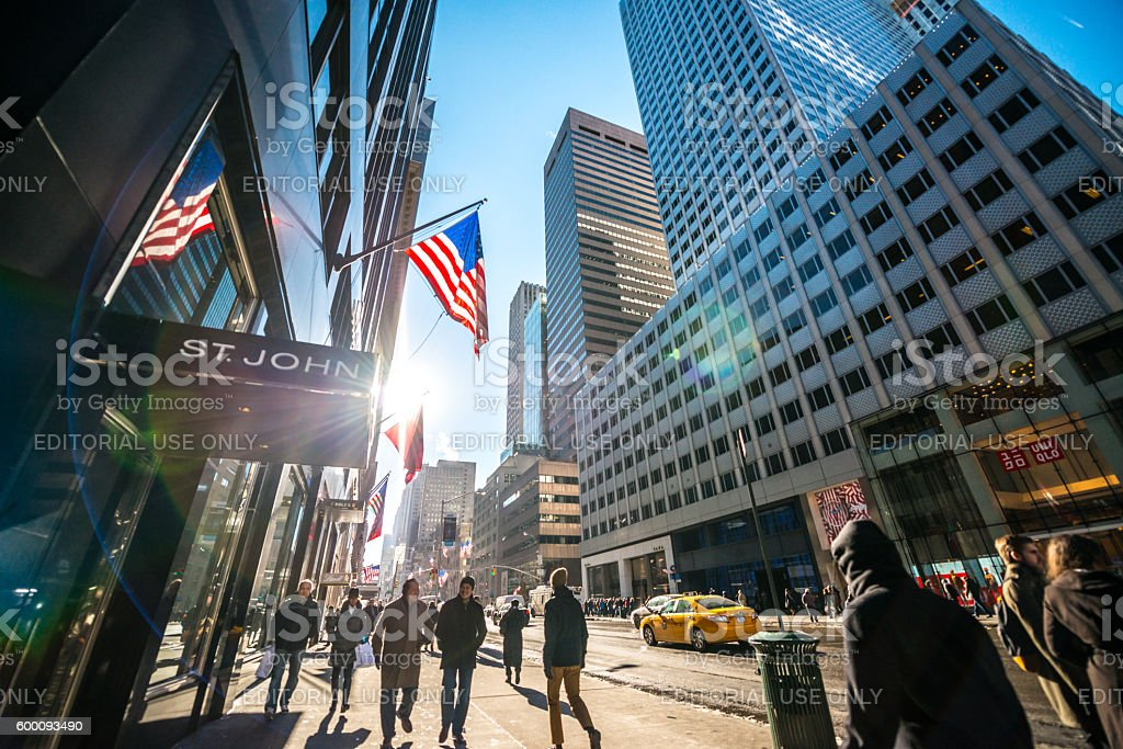 Fifth Avenue with luxury shops and people walking, NYC stock photo