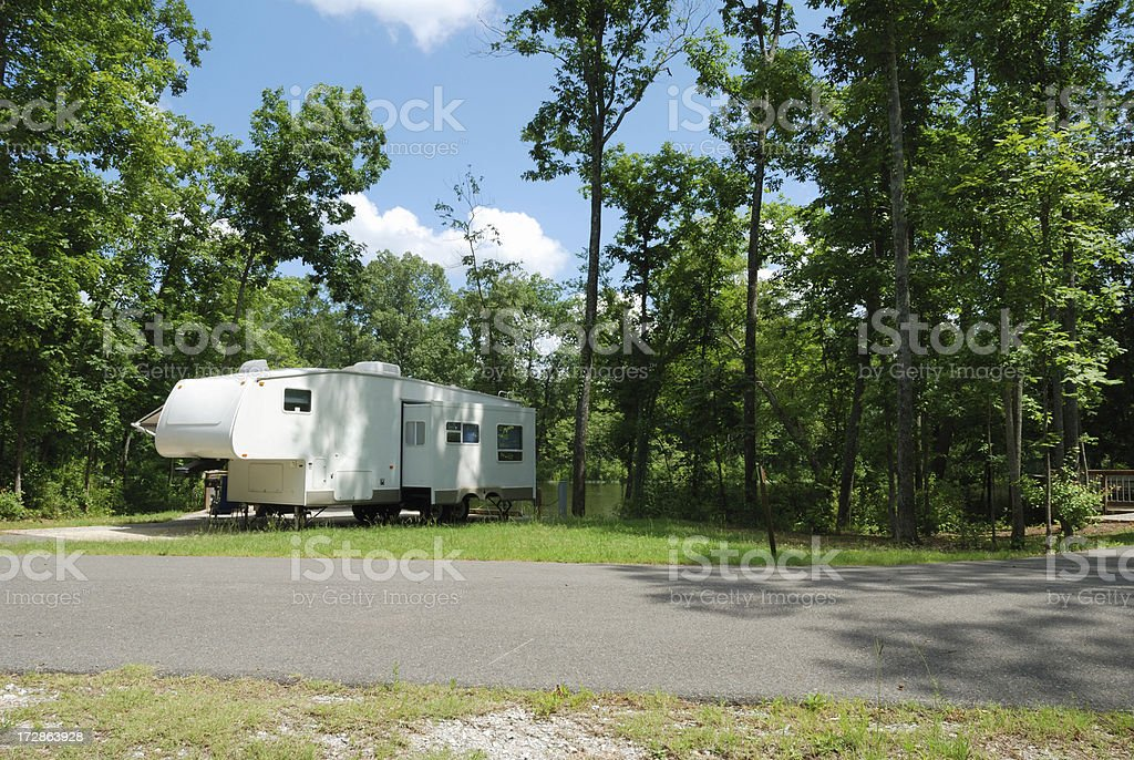Fifth wheel trailer at campsite stock photo