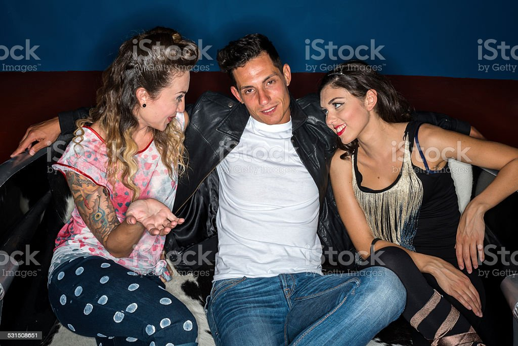 Fifties 1950s style ring flash portraits: friends on couch stock photo