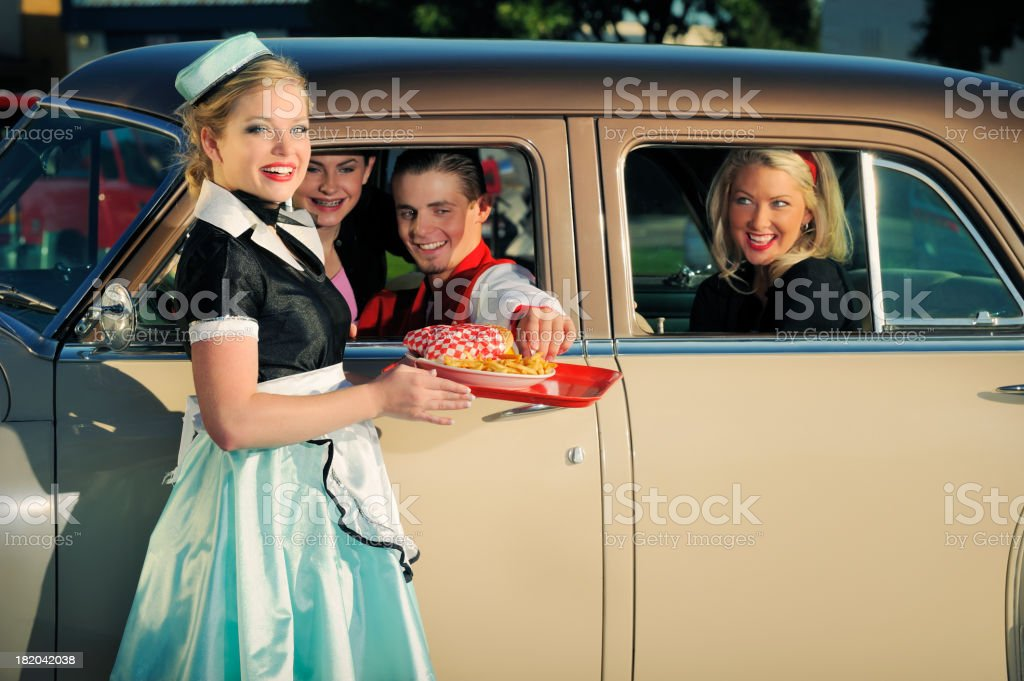 Fifties Drive In With Car Hop and Customers stock photo