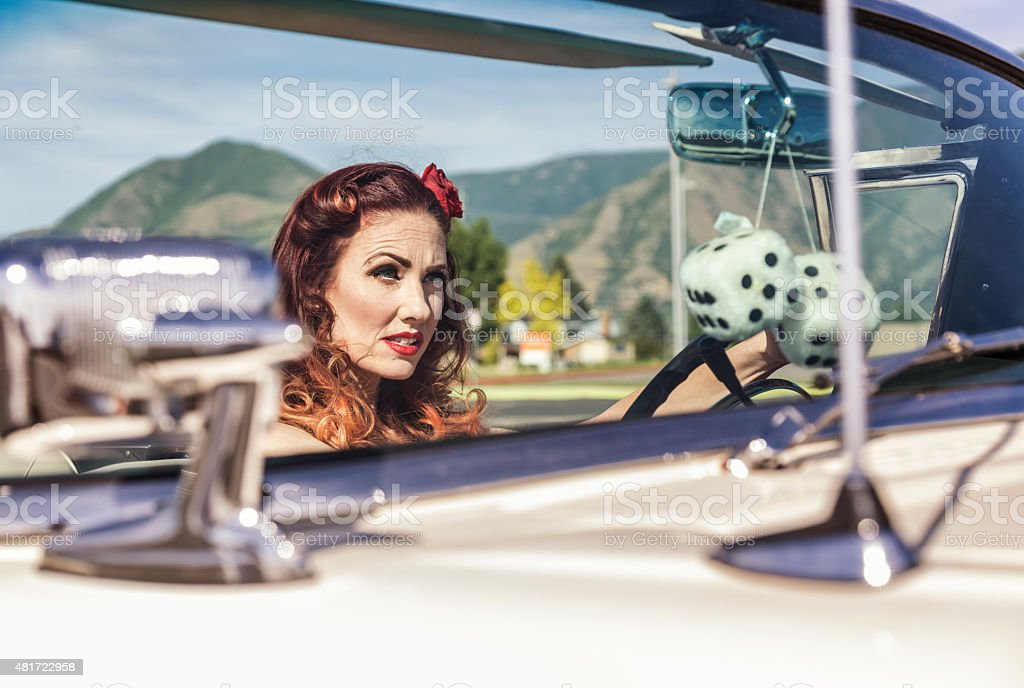 Fifties Glamour Girl Driving Convertible Car stock photo
