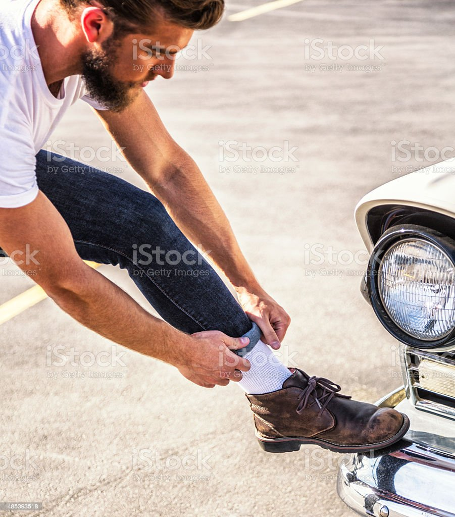 Fifties Greaser Guy Adjusting Tight Jeans stock photo