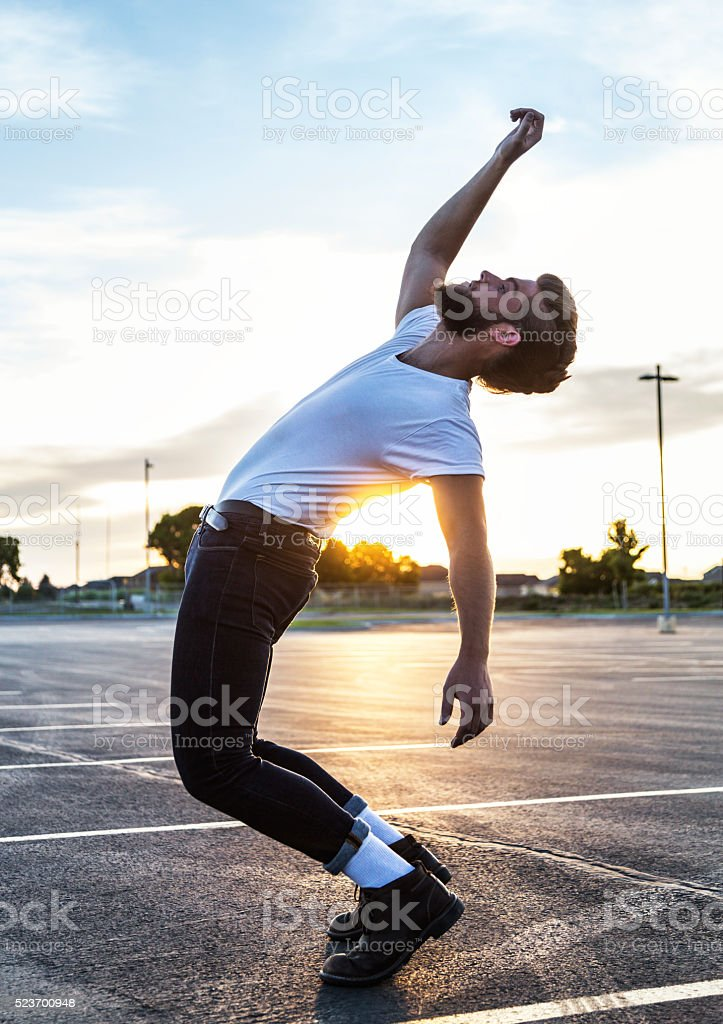 Fifties Greaser Sunset Parking Lot Dancer Bending Backwards stock photo
