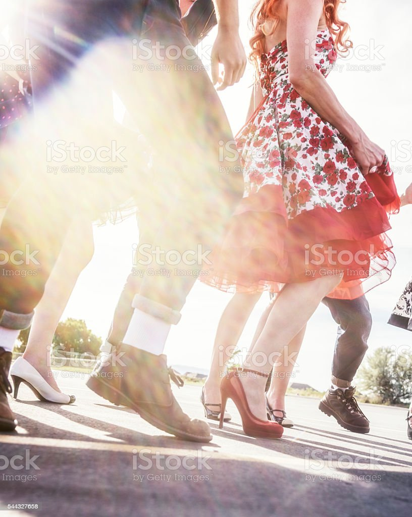 Fifties High School Graduation Sunset Sun Flare Dancers stock photo