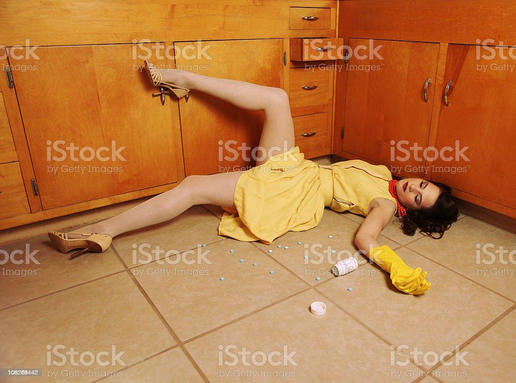 Fifties Housewife Sprawled on Floor stock photo