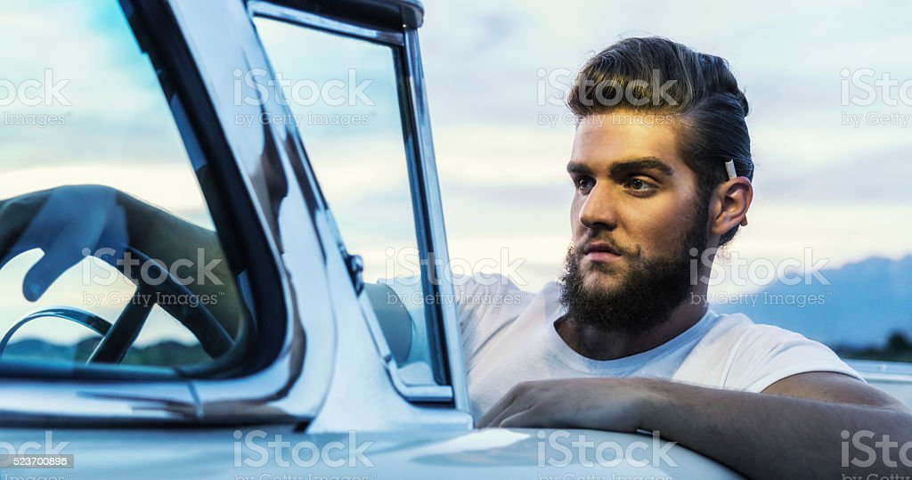 Fifties Pompadour Cool Greaser Guy Driving Classic Convertible Car stock photo