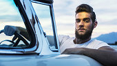 Fifties Pompadour Greaser Hipster Guy Driving Classic Convertible Car