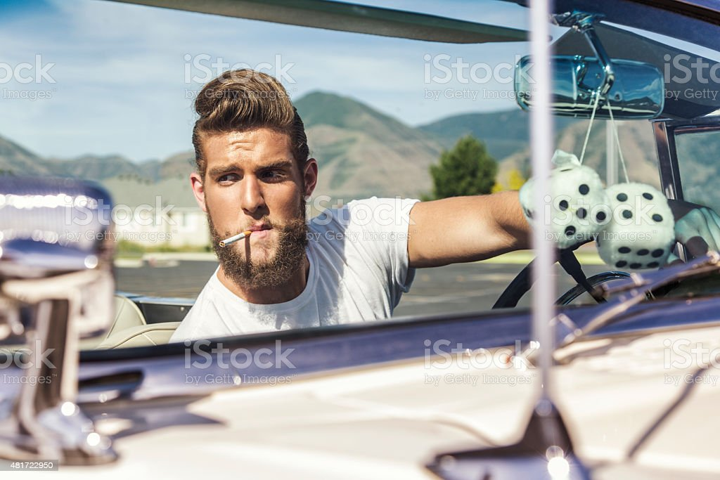Fifties Pompadour Hair Greaser Guy Driving Convertible Car stock photo