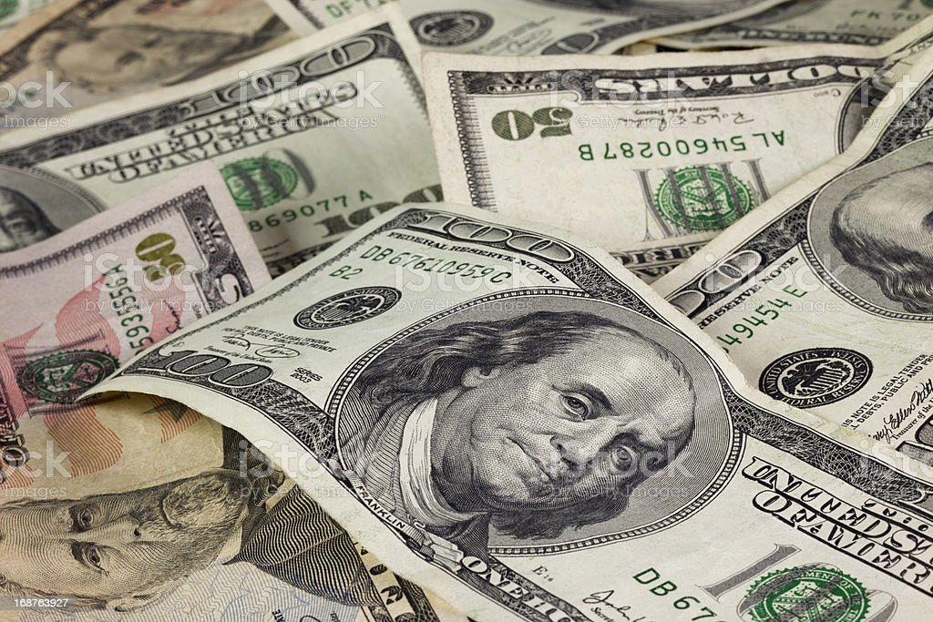 Fifty and Hundred Dollar Bills stock photo