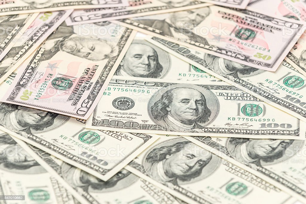 Fifty and one hundred dollars banknotes on the table stock photo
