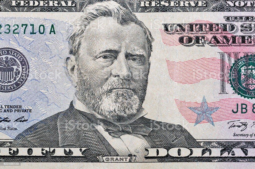 Fifty dollars bill fragment closeup stock photo